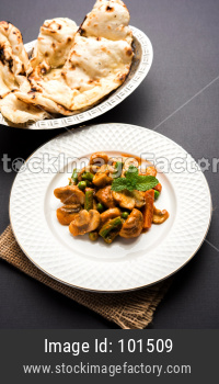 Mushroom Masala Fry served with Naan, selective focus