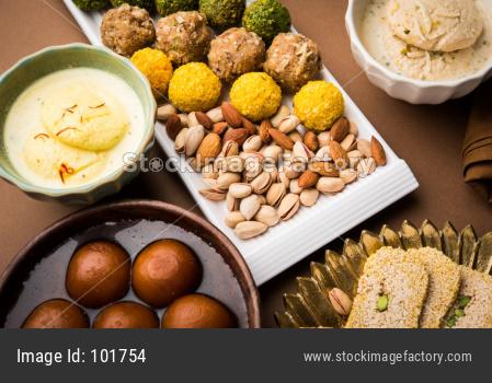 Indian sweet food group photo. Dry fruit laddu, kaju katli or kaju burfi, gajak or til papdi, rasmalai or Rasmalai