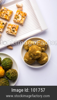 Indian sweet food group photo. Dry fruit laddu, kaju katli or kaju burfi, gajak or til papdi, rasmalai or Rasmalai