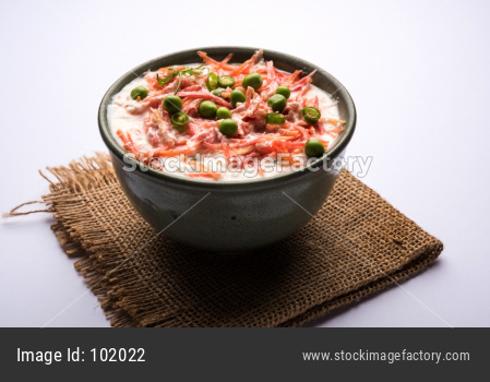 Carrot raita OR Gajar Koshimbir with Curd, green peas, chillies and coriander