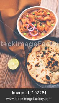 Aloo Gobi Masala OR cauliflower Curry served with Indian bread / Naan / Roti