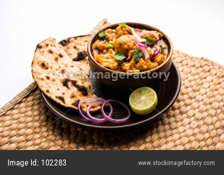 Aloo Gobi Masala OR cauliflower Curry served with Indian bread / Naan / Roti