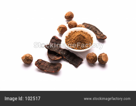 Dried Shikakai and Reetha OR Soapnut Powder in a bowl, selective focus