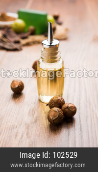 Aritha or Reetha and oil.  Soap-nuts is used as the main ingredient in soaps and shampoos also known as Sapindus emarginatus