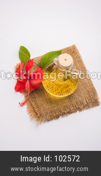 Jaswand or Hibiscus oil and bath soap/shampoo with flower and Reetha fruit and white towel