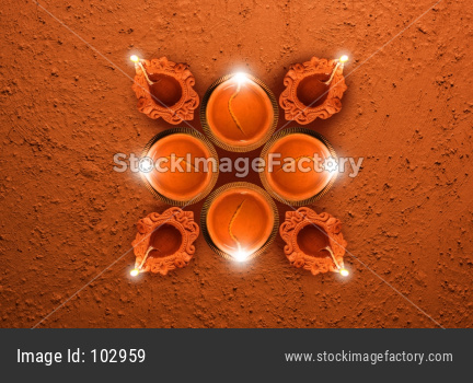 Happy Diwali Greeting card using  Diwali diya shape created using many Diyas