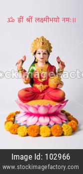 Happy Diwali Greeting Card - Beautiful Clay Idol of Hindu Goddess Lakshmi OR Laxmi, selective focus