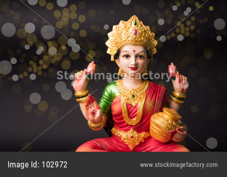 Beautiful Clay Idol of Hindu Goddess Lakshmi OR Laxmi, selective focus