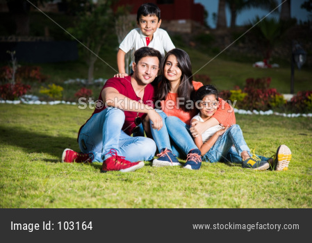 Portrait of Happy Indian/Asian Family sitting outdoor