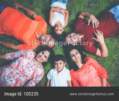 Indian family forming circle with heads touching each other