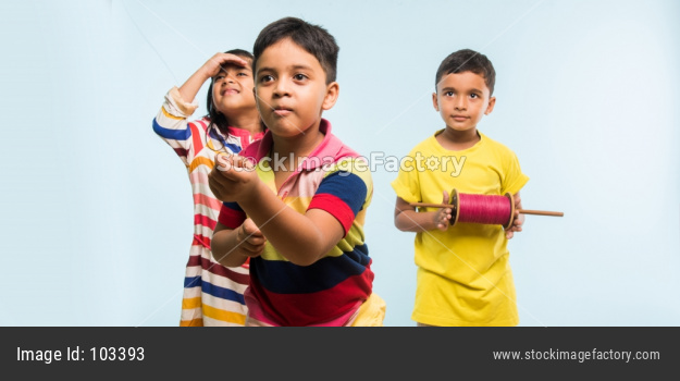 Indian kids flying kite on Makar Sankranti