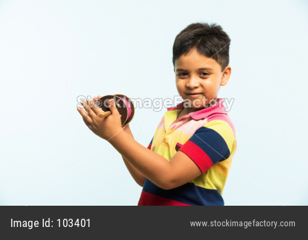 Indian boy holding fikri / spindal / reel on makar sankranti