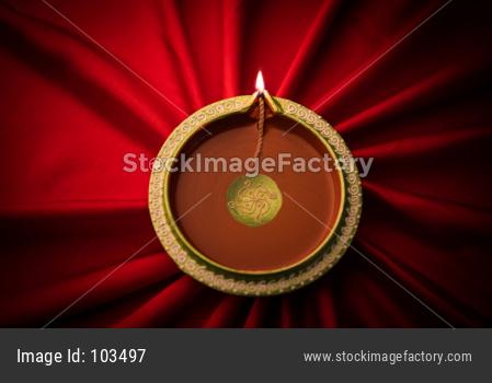 Big Diwali diya over silk cloth - happy diwali greeting card