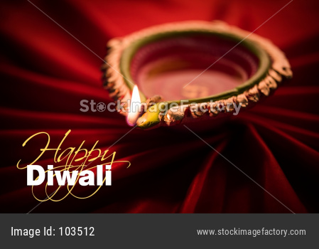 Big Diwali diya over silk cloth - happy diwali greeting card
