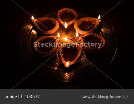 Happy Diwali - many Terracotta diya or oil lamps