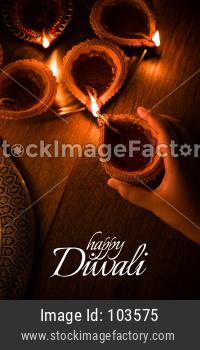 Happy Diwali - many Terracotta diya or oil lamps