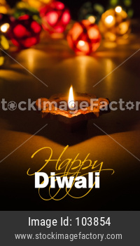 Happy Diwali Greeting Card showing Illuminated diya and bokeh