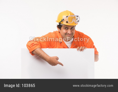 Indian/Asian electrician or electrical engineer in action