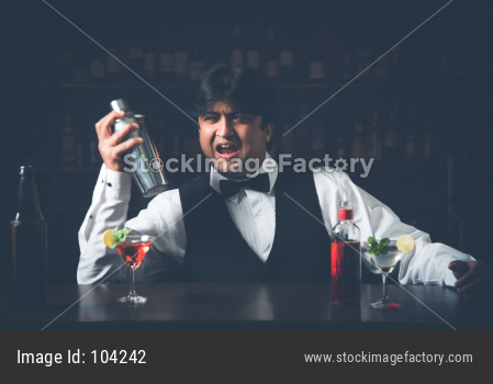 Indian/Asian Bartender making  cocktail in restaurant
