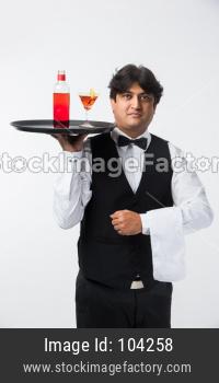 Indian/Asian Bartender making  cocktail in restaurant