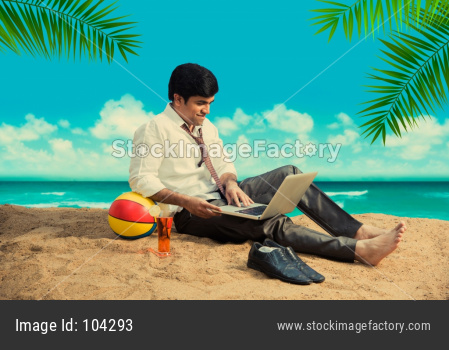 Indian/Asian Handsome businessman at beach