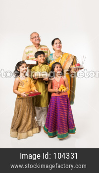 Grandparents celebrating festival with grand children, isolated over white background