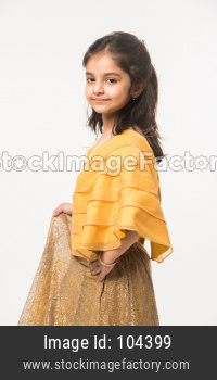 cute little Indian girl in traditional wear with gifts and smiling and standing isolated over white background