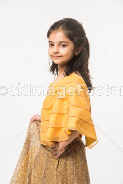 4a330aae004e Cute Little Indian Girl In Traditional Wear With Gifts And Smiling And  Standing Isolated Over White Background Photo 0000104399 - StockImageFactory