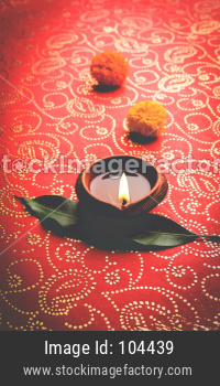 beautiful diwali diya or oil lamp with gifts