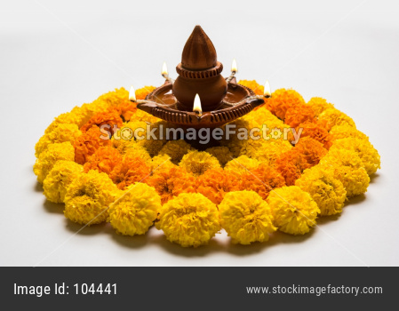 flower rangoli with diya for diwali celebration