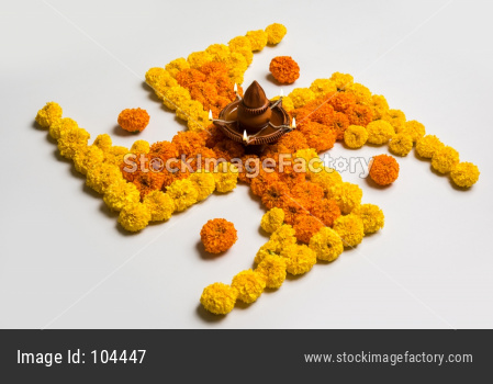 swastik and flower rangoli