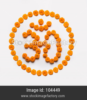 Stock photo of word Aum or om made using marigold flower arrangement