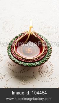 beautiful diwali diya or oil lamp with gifts
