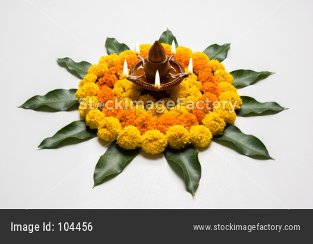 flower rangoli with diya for diwali celebration