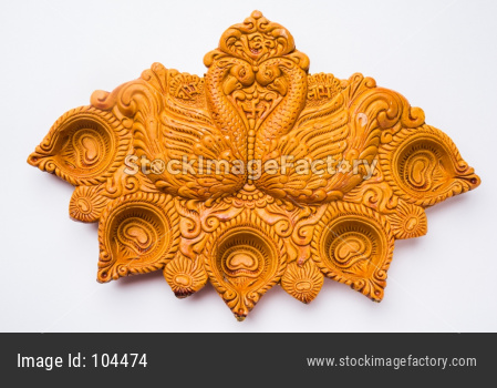 Carved Designer Diwali Diya Plate made up of Terracotta, isolated