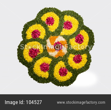 flower rangoli for Diwali or pongal with diya or clay oil lamp