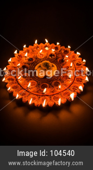 Beautiful illuminated terra-cotta Diwali diya Plate