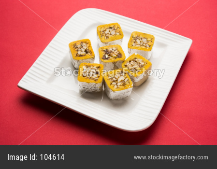 sweet Mawa burfi for diwal wrapped with silver foili, selective focus