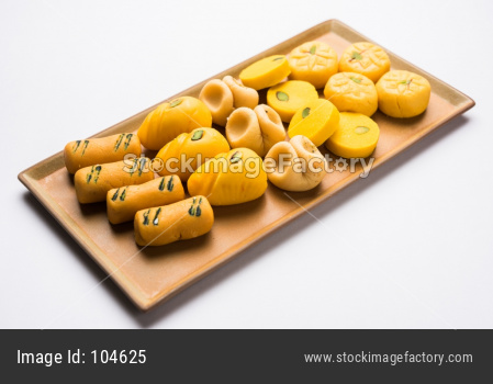 variety of sweets or orange peda or pedha or pera made up of milk, khoya, sugar , saffron etc