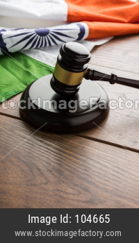 Indian Law concept showing wooden Gavel and Indian Flag