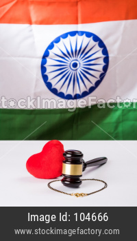 breakup or divorce in India showing Gavel, stuffed red heart, mangalsutra or necklace