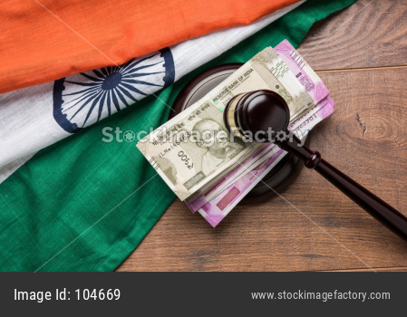 Indian Currency Rupee Notes with Law Gavel isolated on white