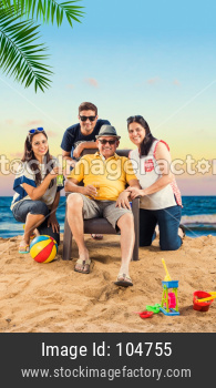 Indian  Family enjoying at beach, posing for picture