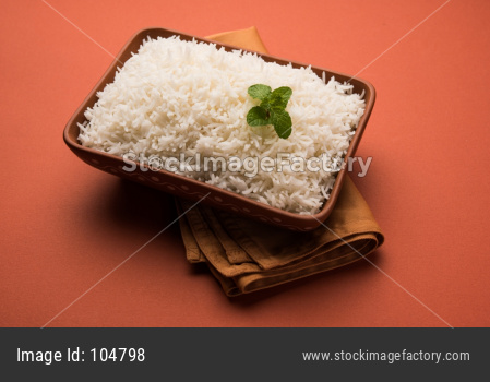 Cooked plain white basmati rice in terracotta bowl