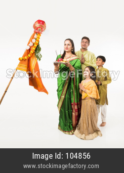 Indian family celebrating Gudi Padwa or Ugadi festival which is a hindu new year