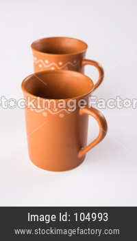 Empty terracotta mug or brown clay coffee cup or jar or drinking glass, isolated over white