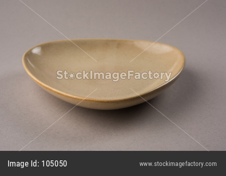 Empty triangular shape ceramic plate
