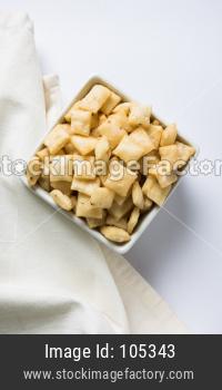 Shakkar pare / Shakkarpare / shankar pale is a sweet and salty tea time snack food from India