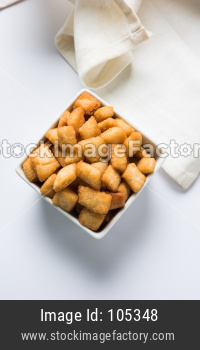 Shakkar pare / Shakkarpare / shankar pale is a sweet and salty tea time snack food from India
