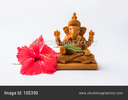 lord ganesha idol with pooja or puja thali, bundi laddu/modak, durva and hibiscus or jasvand flower